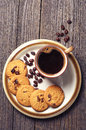 Cup of coffee and cookies top view on tasty chocolate Royalty Free Stock Image