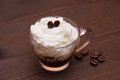 Cup with coffee and cream on wooden close Royalty Free Stock Photo