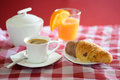 Cup of coffee, croissant, orange juice and a sugar bowl Royalty Free Stock Photo