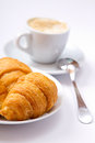 Cup of coffee and croissant on the saucer Royalty Free Stock Photography