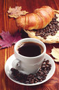 Cup of coffee and croissant on wooden table Stock Photo
