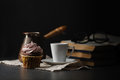 Cup of coffee and cupcake. Time to read an interesting book. Tim Royalty Free Stock Photo