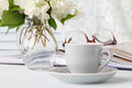 Cup of coffee, flowers and note Royalty Free Stock Photo