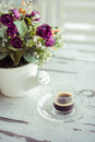 Cup of coffee with flowers on vintage table Royalty Free Stock Photos