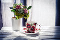 Cup of coffee and flowers Royalty Free Stock Photo