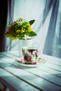 Cup of coffee and flowers on white wooden table retro colors Royalty Free Stock Images