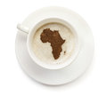 Cup of coffee with foam and powder in the shape of Africa.(series) Royalty Free Stock Photo