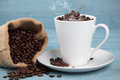 Cup with coffee grains Royalty Free Stock Photo