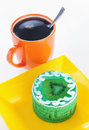 Cup of coffee and green cake with kiwi Royalty Free Stock Photography
