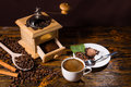 Cup of Coffee with Hand Grinder and Roasted Beans Royalty Free Stock Photo
