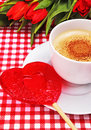 Cup of coffee with heart-shaped candy Royalty Free Stock Photos