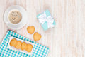 Cup of coffee, heart shaped cookies and gift box Royalty Free Stock Photo