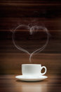 Cup of coffee with heart-shaped smoke Royalty Free Stock Photo