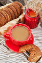 Cup of coffee and homemade cookies hot in a red for breakfast Royalty Free Stock Images
