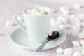 Cup of coffee or hot chocolate with whipped cream on the table a Royalty Free Stock Photo