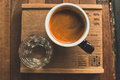 Cup of coffee,  hot espresso with glass of water Royalty Free Stock Photo
