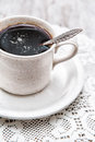 Cup of coffee on the lace napkin and old wood background Royalty Free Stock Images