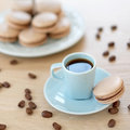 Cup of coffee with macaron blue Royalty Free Stock Image
