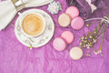 Cup of coffee with macaroons and decoration on the purple paper horizontal Royalty Free Stock Photo