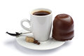 Cup of coffee and marshmallows with chocolate on white Royalty Free Stock Photography