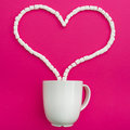 Cup of coffee and marshmallows on pink background. Heart. Flat lay. Top view Royalty Free Stock Photo