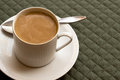 Cup of Coffee with Milk on a Green Place Mat Royalty Free Stock Photography