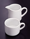 Cup of coffee and milk jug Stock Image