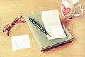 Cup of coffee with notebook and blank memo Royalty Free Stock Photo