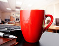 Cup of coffee in office red Royalty Free Stock Photos