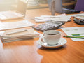 A cup of coffee and office supplies in meeting room Royalty Free Stock Photo