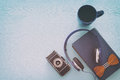 cup of coffee, old book, vintage photo camera and headphones Royalty Free Stock Photo