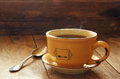 Cup of coffee on old wooden table. morning workspace, coffee break .retro filtered image and selective focus Royalty Free Stock Photo