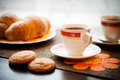 Cup of coffee photo with the image a and confectionery products Royalty Free Stock Images