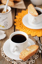 A cup of coffee with pumpkin biscotti and almond copy space for your text Royalty Free Stock Images