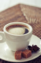 Cup of coffee on rattan placemat closeup Royalty Free Stock Photography