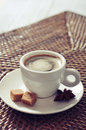 Cup of coffee on rattan placemat closeup Royalty Free Stock Images