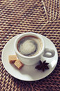 Cup of coffee on rattan placemat closeup Stock Photo