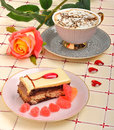Cup of coffee, a rose and a cake Royalty Free Stock Photo