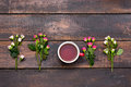 Cup of coffee with roses, top view Royalty Free Stock Photo