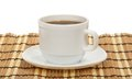 Cup of coffee and saucer on a bamboo napkin изо ировання white Stock Images