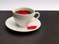 Cup of coffee scented by the red rose petal Stock Image