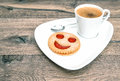 Cup coffee smiley face cookie. Funny breakfast Royalty Free Stock Photo