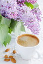 Cup of coffee and spring flowers Stock Photos