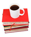 Cup of coffee on stack of books isolated white background Stock Images