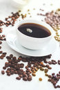 Cup of coffee with steam and coffee beans Royalty Free Stock Photo