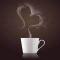Cup of coffee with steam in heart shape in front of brown background Stock Photos