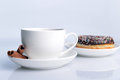 Cup of coffee with sweet donut Stock Images