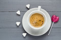 Cup coffee sweets heart shaped lollipop sugar cubes Royalty Free Stock Photo