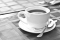 A cup of coffee on the table in black and white Stock Photos