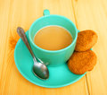 Cup coffee on table and liver from tree Stock Photos